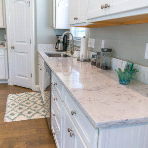 Arctic Ivory Quartz counter on with white cabinets countertop top angle
