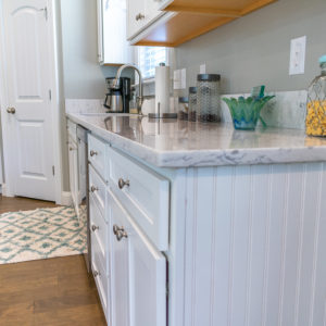 Arctic Ivory Quartz counter on with white cabinets