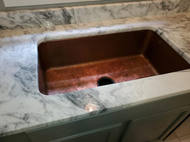 mont-blanc-marble-countertops-with-copper-single-bowl-sink