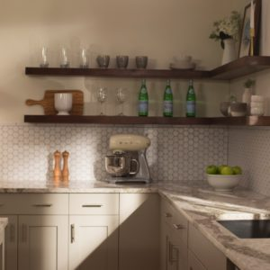 Beaumont quartz kitchen countertops paired with hexagonal tile backsplash