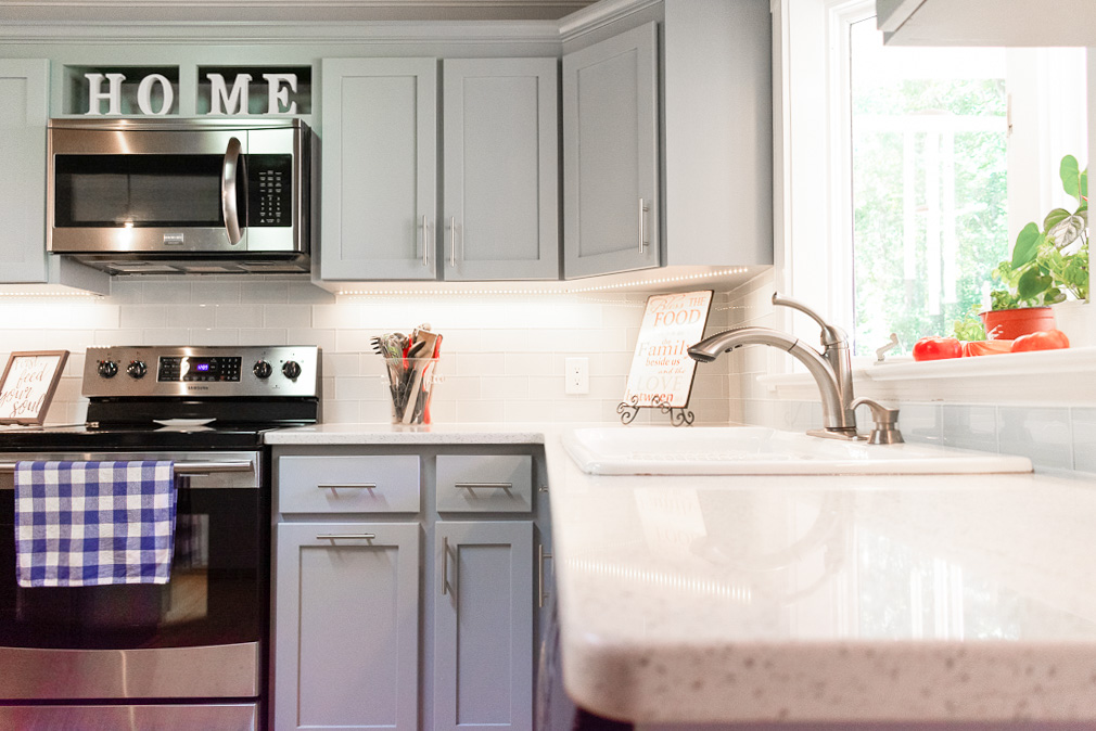 White Lace Quartz Countertops with Gray Cabinets